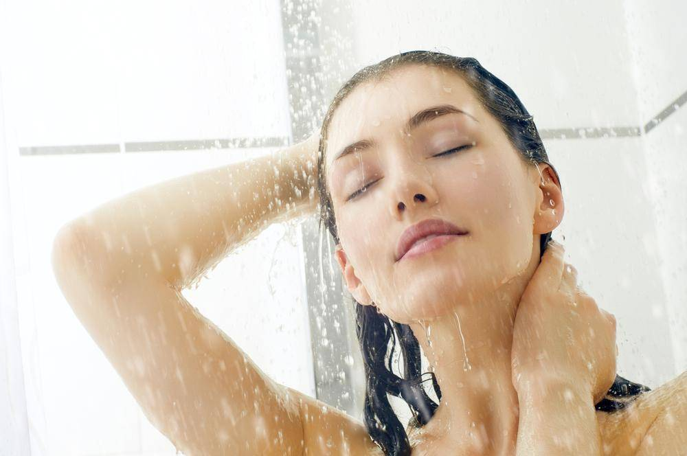 Girl taking a shower in winter